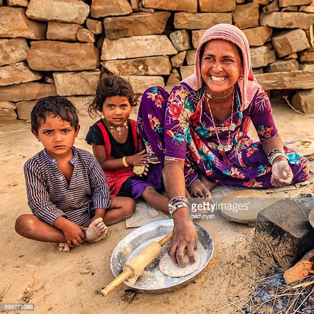 Indian woman preparing food - chapatti, flat bread, desert village