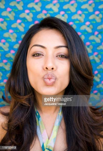 Indian woman puckering her mouth