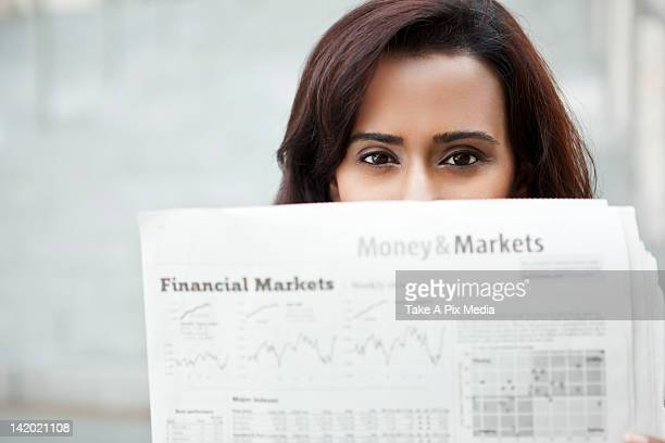 Indian woman reading newspaper
