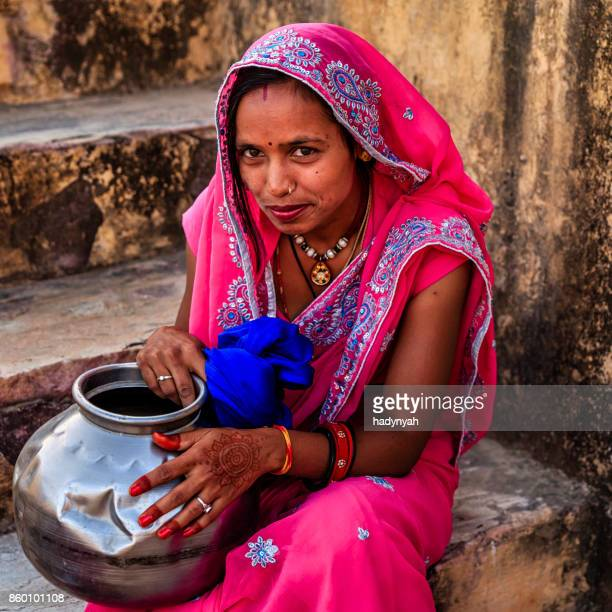 indian woman resting in village near jaipur, india - stepwell stock pictures, royalty-free photos & images