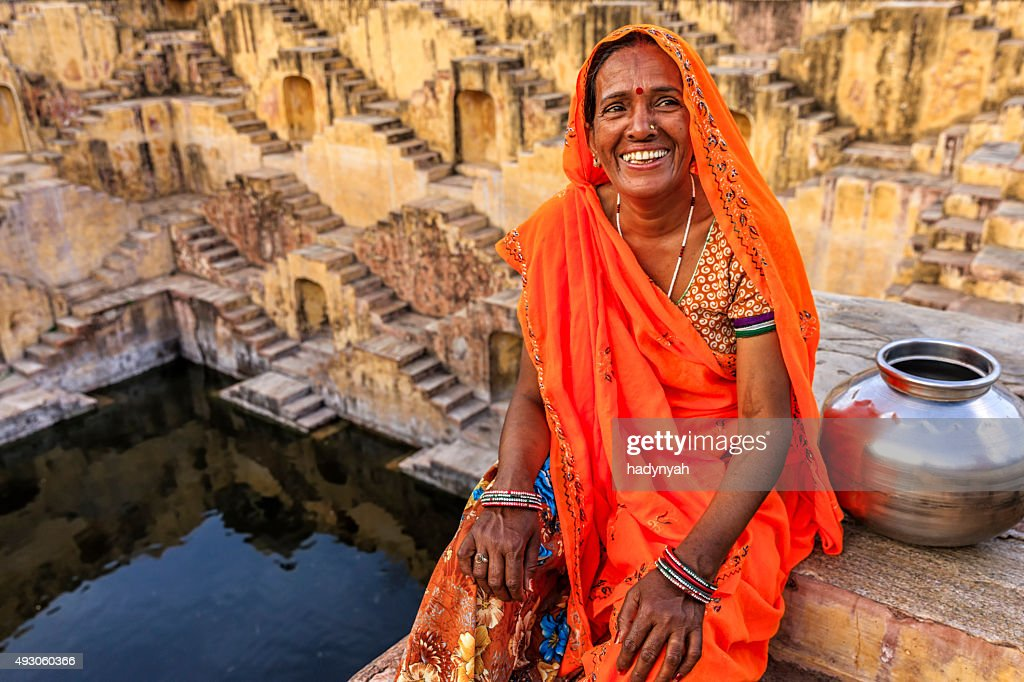Indian woman resting inside stepwell in village near Jaipur, India : Stock Photo