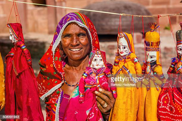 Indian woman selling hand made puppets