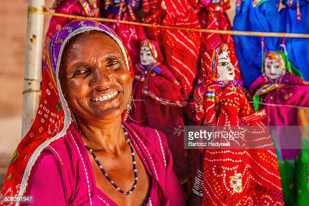 indian woman selling hand made puppets - puppet maker stock pictures, royalty-free photos & images