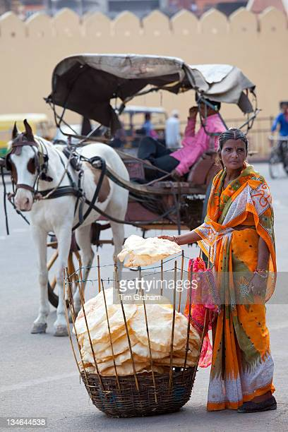 Indian woman selling poppadoms by The Observatory in Jaipur, Rajasthan, India