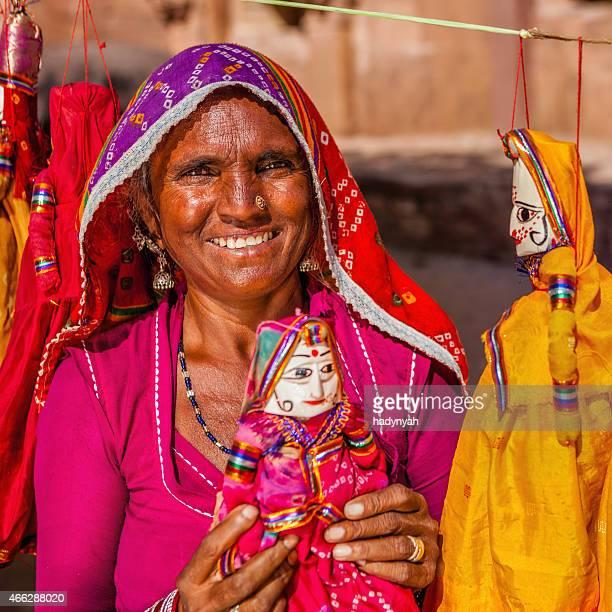 Indian woman selling puppets. Jodhpur, Rajasthan.