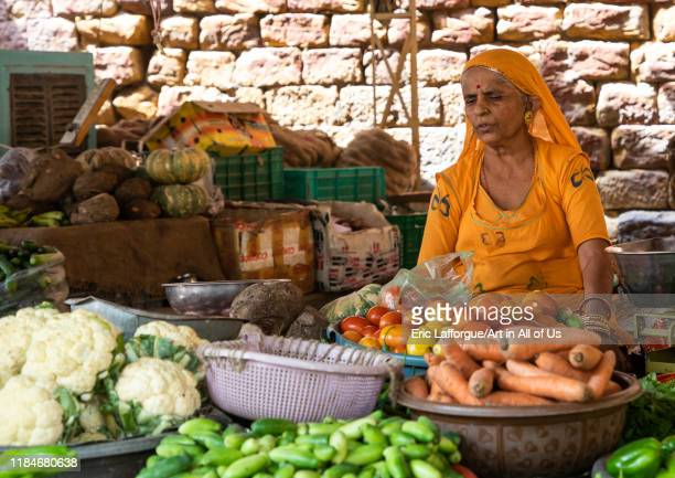 Indian woman selling vegetables in a market Rajasthan Jaisalmer India on July 22 2019 in Jaisalmer India