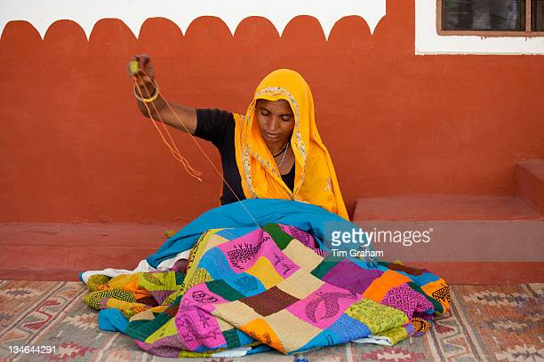Indian woman sewing textiles at Dastkar women's craft cooperative the Ranthambore Artisan Project in Rajasthan Northern India