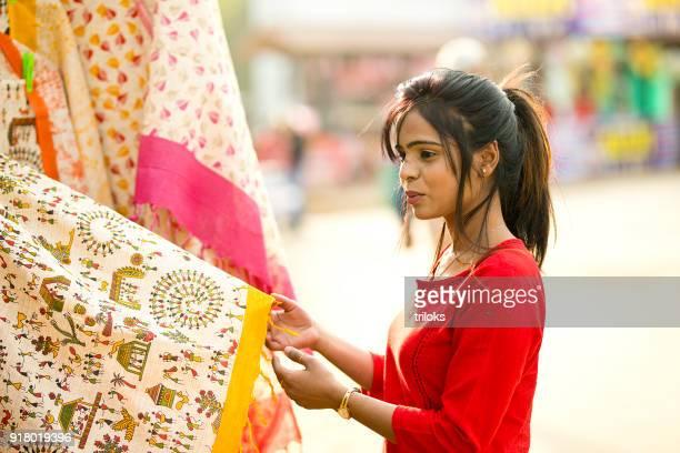indian woman shopping for sari at street market - sari stock pictures, royalty-free photos & images
