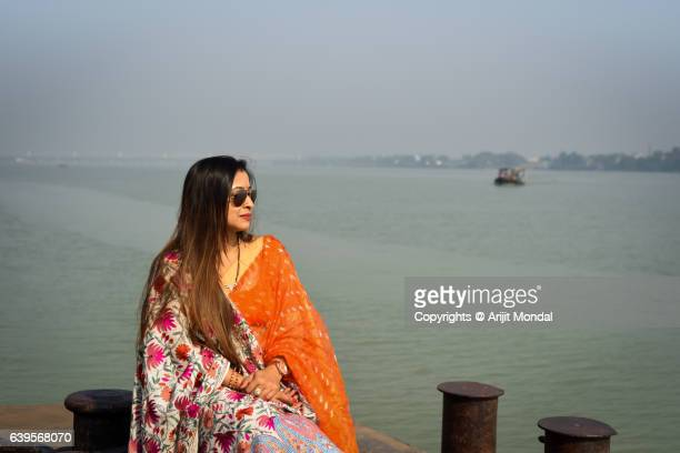 Indian Woman Sitting At Harbor in Indian Ethnic Clothing