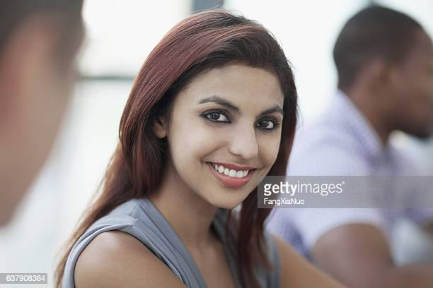 Indian woman smiling portrait in meeting