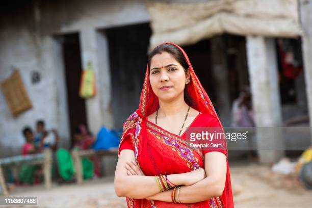 indian woman - stock image - village stock pictures, royalty-free photos & images