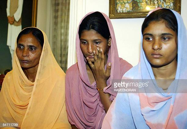 Indian woman Sukhpreet Kaur wife of Sarabjit Singh an Indian national held and sentenced to hang in Pakistan poses with her daughters Poonam and...