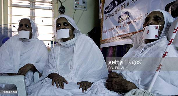 Indian woman Taraben Chovatia rests as she undergoes the Jain practice of Santhara or voluntary death by fasting at an upashray in Mumbai on April 6...