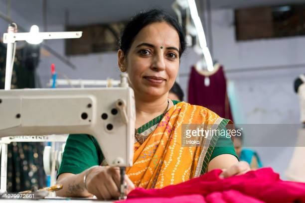 indian woman textile worker on production line - traditional clothing stock pictures, royalty-free photos & images
