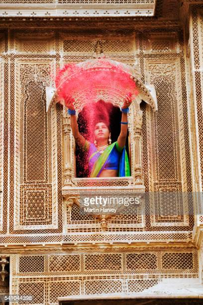 Indian Woman Throwing Holi Powder from Window of Haveli