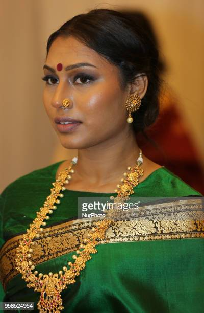 Indian woman wearing an elegant and ornate Kanchipuram saree during a South Indian fashion show held in Scarborough Ontario Canada