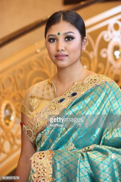 Indian woman wearing an elegant and ornate Kanchipuram saree in Scarborough Ontario Canada