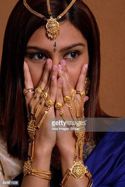 Indian woman wearing traditional wedding jewelry