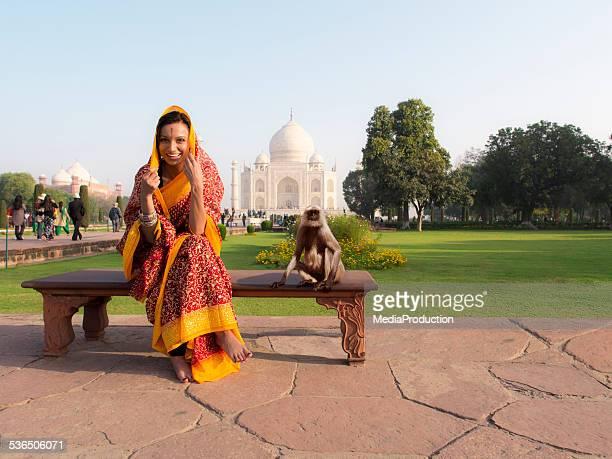 Indian woman with a monkey at Taj Mahal