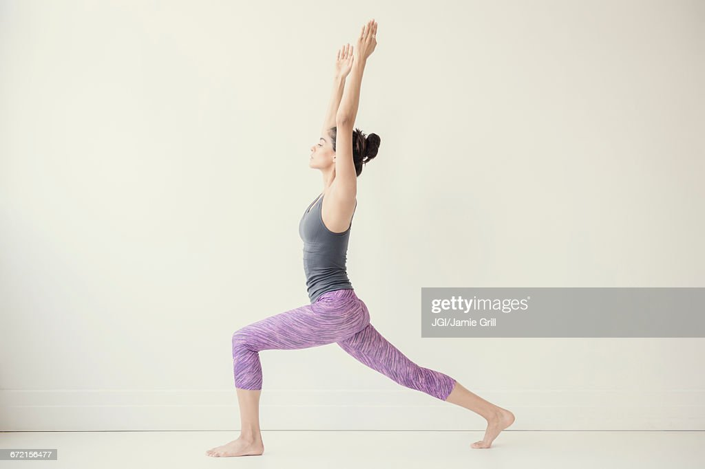Indian woman with arms raised yoga pose : Stock Photo