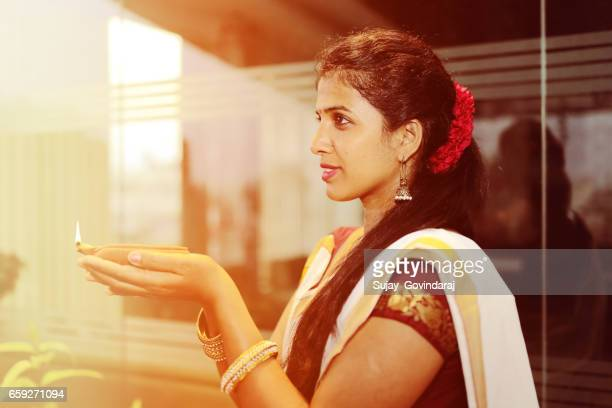 indian woman with diya - diwali celebration stock photos and pictures