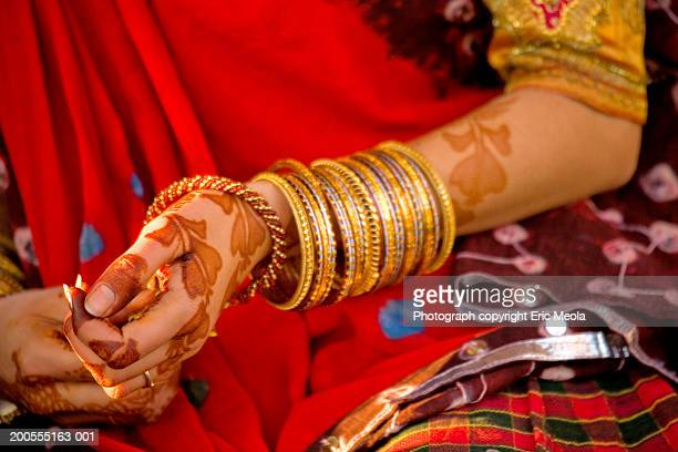 Indian woman with henna markings on hand, close-up