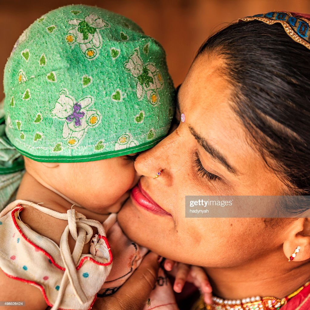 Indian woman with her newborn daughter, Bishnoi village : Stock Photo