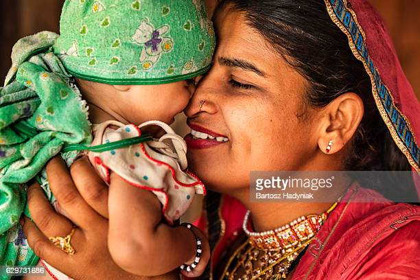 indian woman with her newborn daughter, bishnoi village - indian girl kissing stock photos and pictures