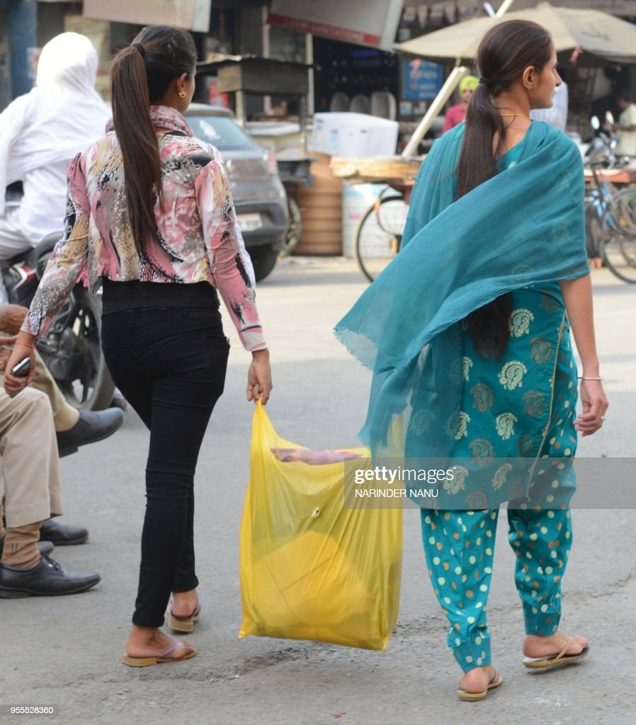 Indian women carry their shopping in a plastic bag in Amritsar on May 5 2018