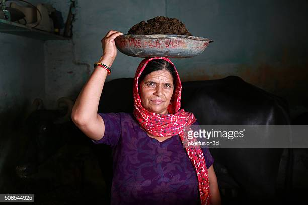 Indian Women Carrying Cattle Dung