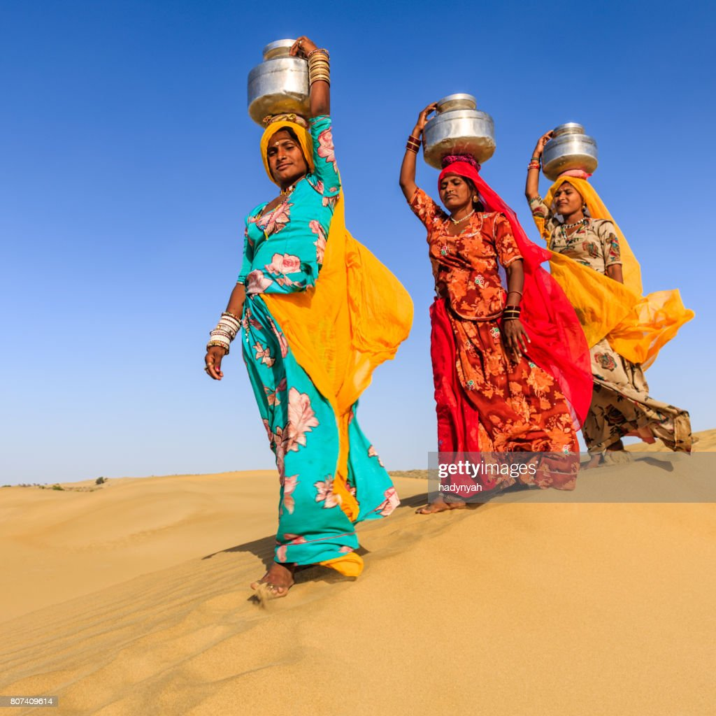Indian Women Carrying On Their Heads Water From Local Well Stock ...