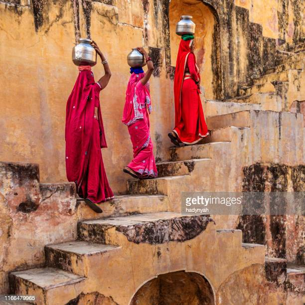 indian women carrying water from stepwell near jaipur - traditional clothing stock pictures, royalty-free photos & images