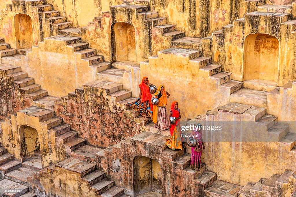 Indian women carrying water from stepwell near Jaipur : Stock Photo