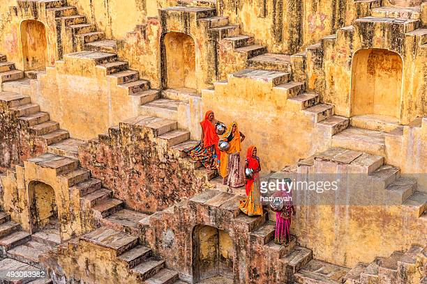 indian women carrying water from stepwell near jaipur - cultures stock pictures, royalty-free photos & images
