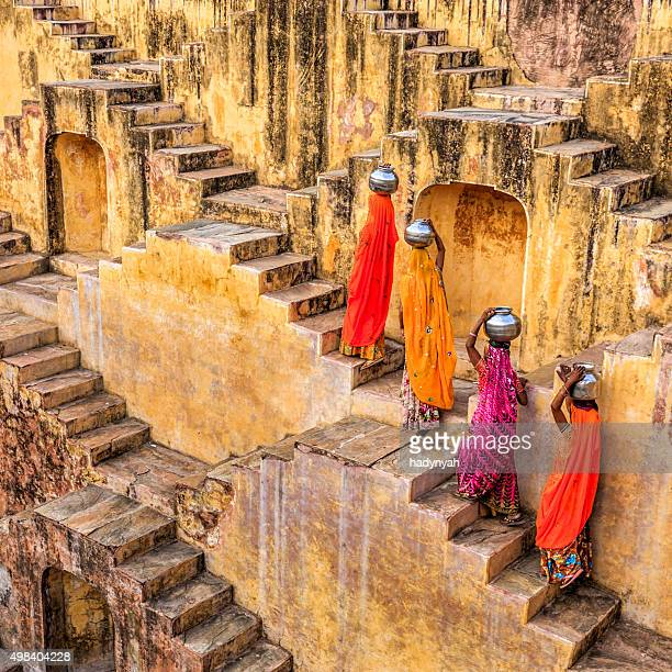 indian women carrying water from stepwell near jaipur - stepwell bildbanksfoton och bilder