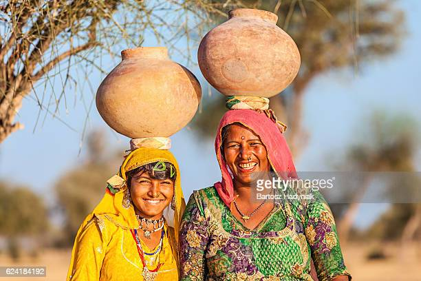 indian women carrying water, rajasthan - village stock pictures, royalty-free photos & images