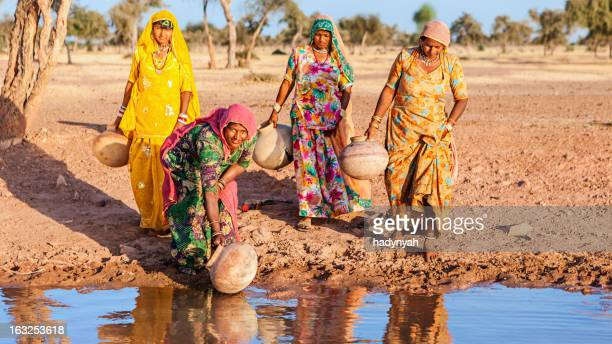 indian women collecting water from a lake, rajasthan - village stock pictures, royalty-free photos & images