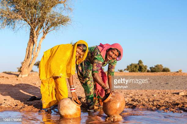 indian women collecting water, rajasthan - indigenous culture stock pictures, royalty-free photos & images