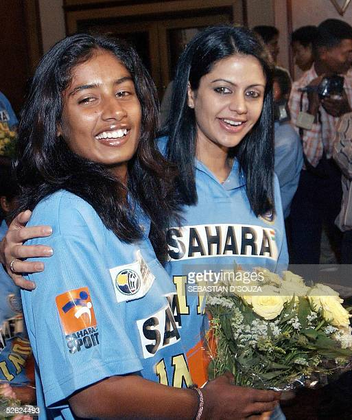 Indian women cricket captain Mithali Raj and Sahara India brand ambassador Mandira Bedi smile at a felicitation function in Bombay for the team's...