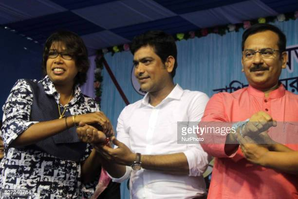 Indian Women Cricket Team member and Star blower Jhulan Ghoswami tying a Rakhi on the wrist of Laxmiratan Shukla and state sports minister Aroop...