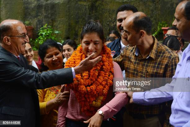 Indian women cricket team member Sushma Verma get emotional while they meet school staff and students during her visit of her old school Government...