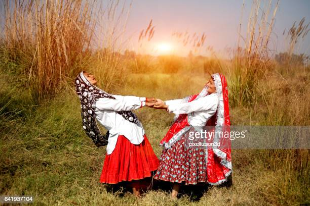 indian women dancing together - haryana stock photos and pictures