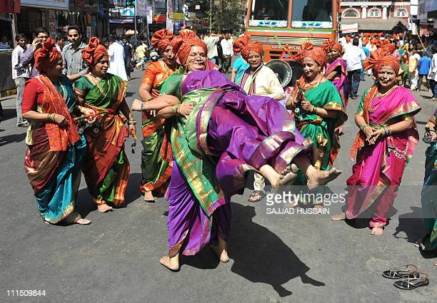Indian women dressed in traditional attire at a procession to celebrate 'Gudi Padwa' or the Maharashtrian new year in Mumbai on April 4, 2011. Gudi...
