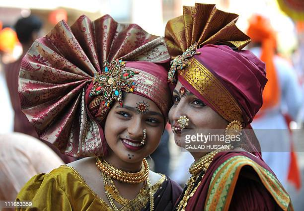Indian women dressed in traditional attire at a procession to celebrate 'Gudi Padwa' or the Maharashtrian new year in Mumbai on April 4 2011 Gudi...