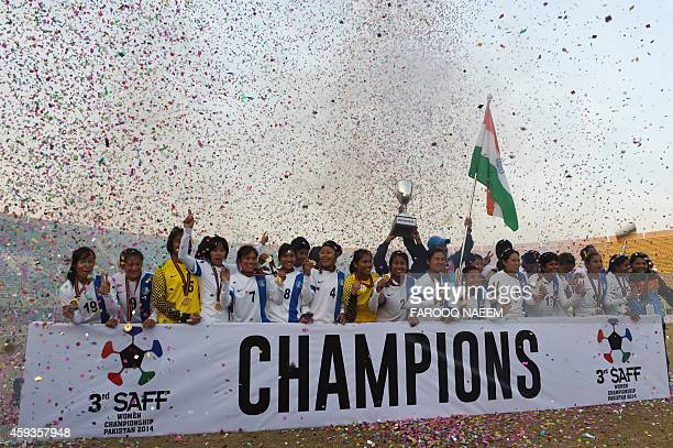 Indian women football team members celebrate their victory after defeating Nepal in the final of the 3rd South Asian Football Federation women's...