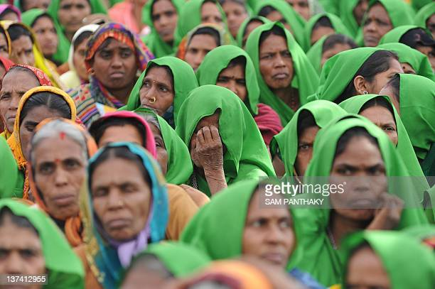 Indian women from Panch Amrut Dairy attend the 23rd Sadbhavana fast of unseen Gujarat state Chief Minister Narendra Modi at Godhra town some 150 kms...