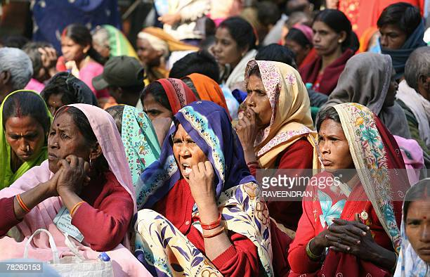 Indian women, from the 'Dalit' or 'Untouchable' caste listen to a speaker during a Dalit Dignity Rally against Congress-led UPA government near...