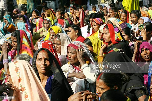Indian women from the 'Dalit' or 'Untouchable' caste listen to a speaker during a Dalit Dignity Rally against Congressled UPA government near...