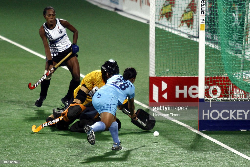Indian Women Hockey Player Rani scores a goal against Fiji during the Hockey World League Round 2 match at Dhyan Chand Stadium on February 21, 2013 in New Delhi, India.