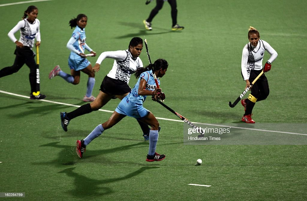 Indian Women Hockey Player Savita negotiating with Fiji players during the Hockey World League Round 2 match at Dhyan Chand Stadium on February 21, 2013 in New Delhi, India.